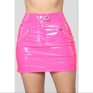 neon pink mini skirt.